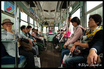 People are Traveling in an Old Tram in Kumamoto, Kyushu Region, Kyushu Island, Japan