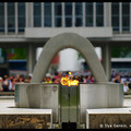 Peace Flame with the Peace Memorial Museum in the background, Hiroshima, Honshu, Japan